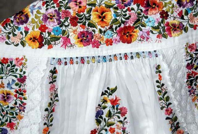 http://www.mexconnect.com/photos/8003-8-p-lavish-hand-embroidery-covers-a-traditional-mexican-weddin