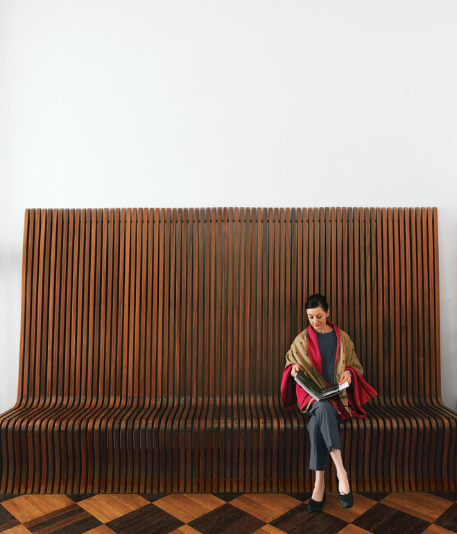 Vintage rosewood bench designed by the Swiss-born British architect Richard Seifert.