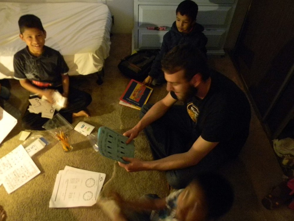 One volunteer mentoring students in their homes.