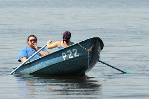 Bad-husbands-fat-man-in-boat-smoking-while-girl-ro1