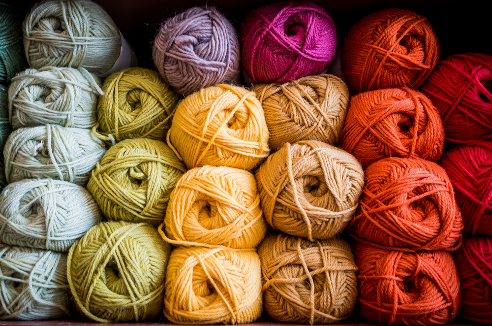 Recently I took some images specifically to be used for a knit and crochet crafter's business cards. She wanted images that conveyed her creativity, love of bright colors, and knack for creating custom knit items out of raw materials. We ended up deciding together that neatly organized bundles of unbranded yarn  of various colors would be our best approach.