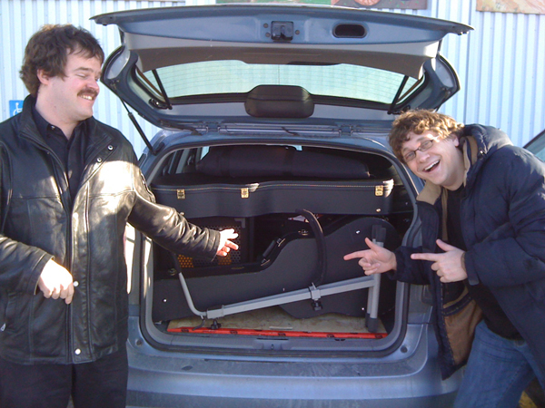 On the road and packing the car so everything fits like a glove!   Keith Rempel (bass), Chris Tabbert (guitar, mandolin).