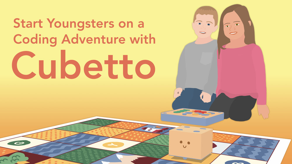 Two kids with a Cubetto