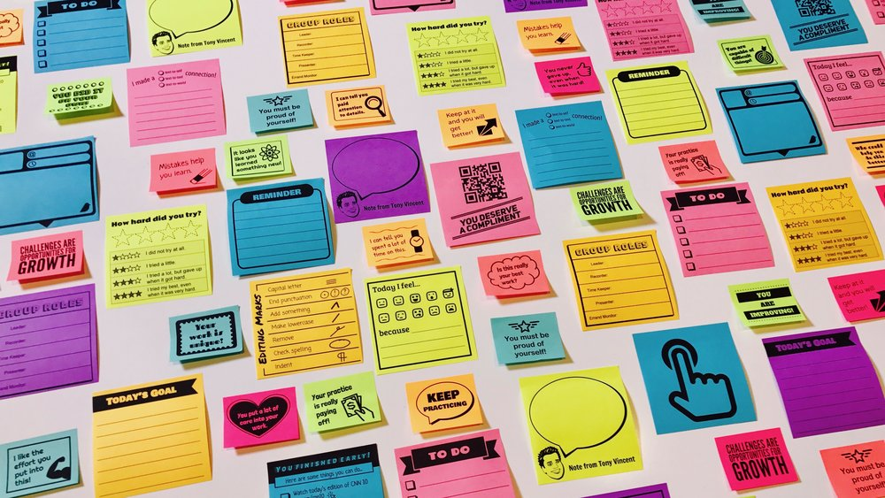 Assortment of colorful sticky notes that have been printed on