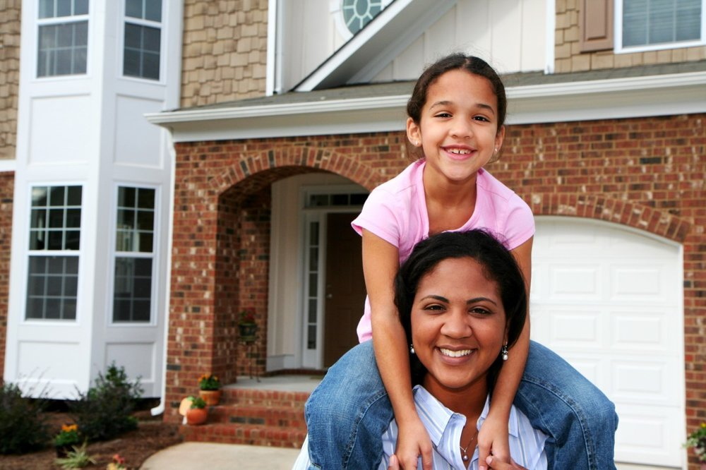 Indian-Hispanic-Mother-Daughter-Female-child-kid-woman-in-front-of-home_13298747_xl.jpg