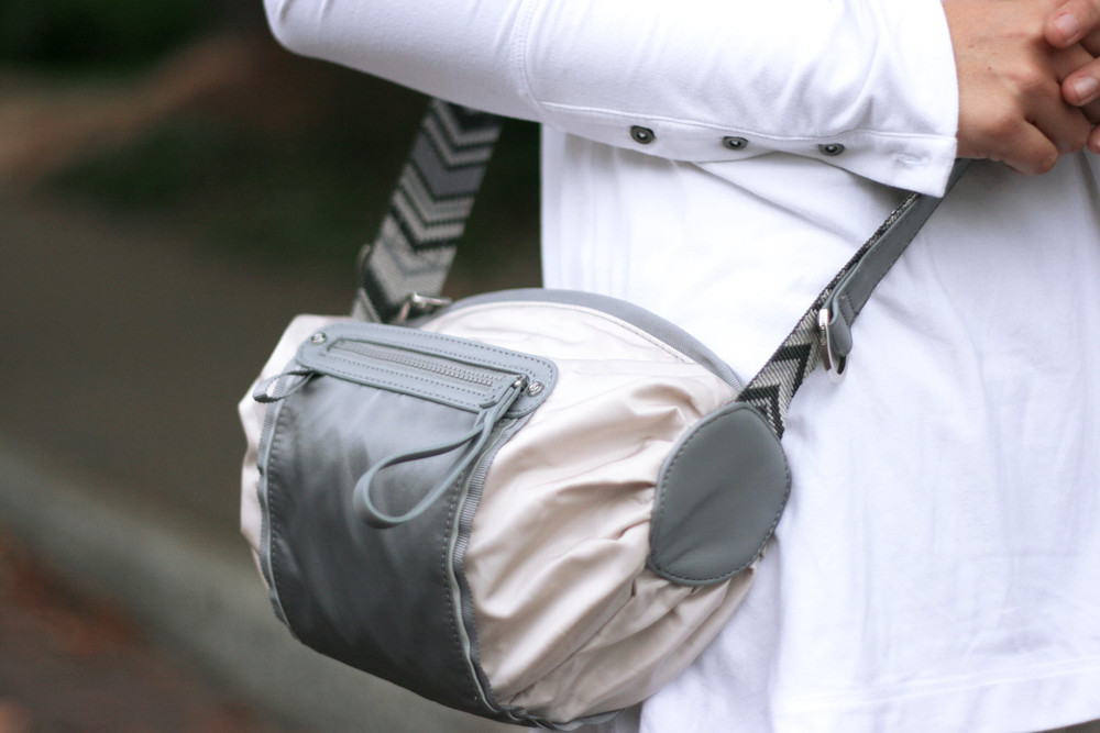Unclip from your handlebars and wear cross-body