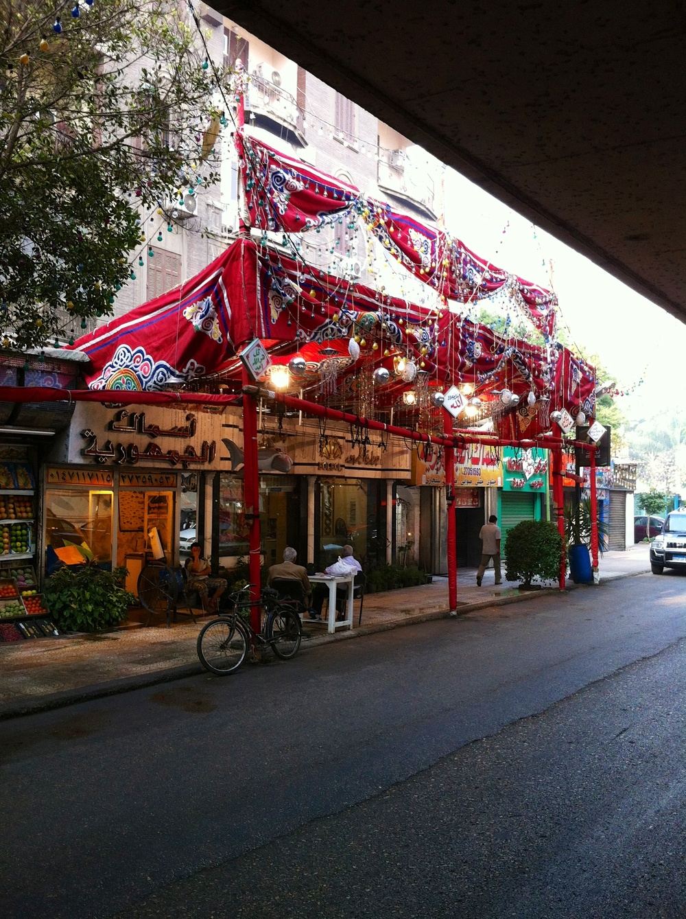 Eid out the front of a Zamalek butcher on 26 July Street
