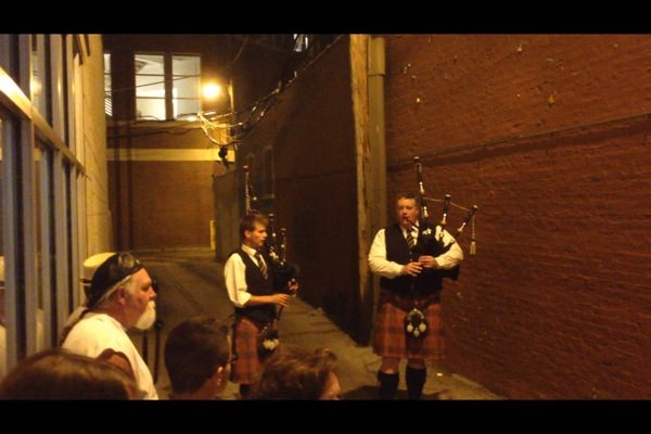 Bagpipe procession concluding in Chicago's most famous alley, just south of the Biograph Theater on Lincoln Ave.