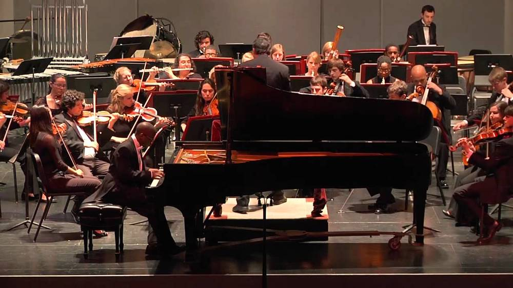 Fort Lee School of Music piano teacher Kyle Walker performing with the east carolina university symphony orchestra.
