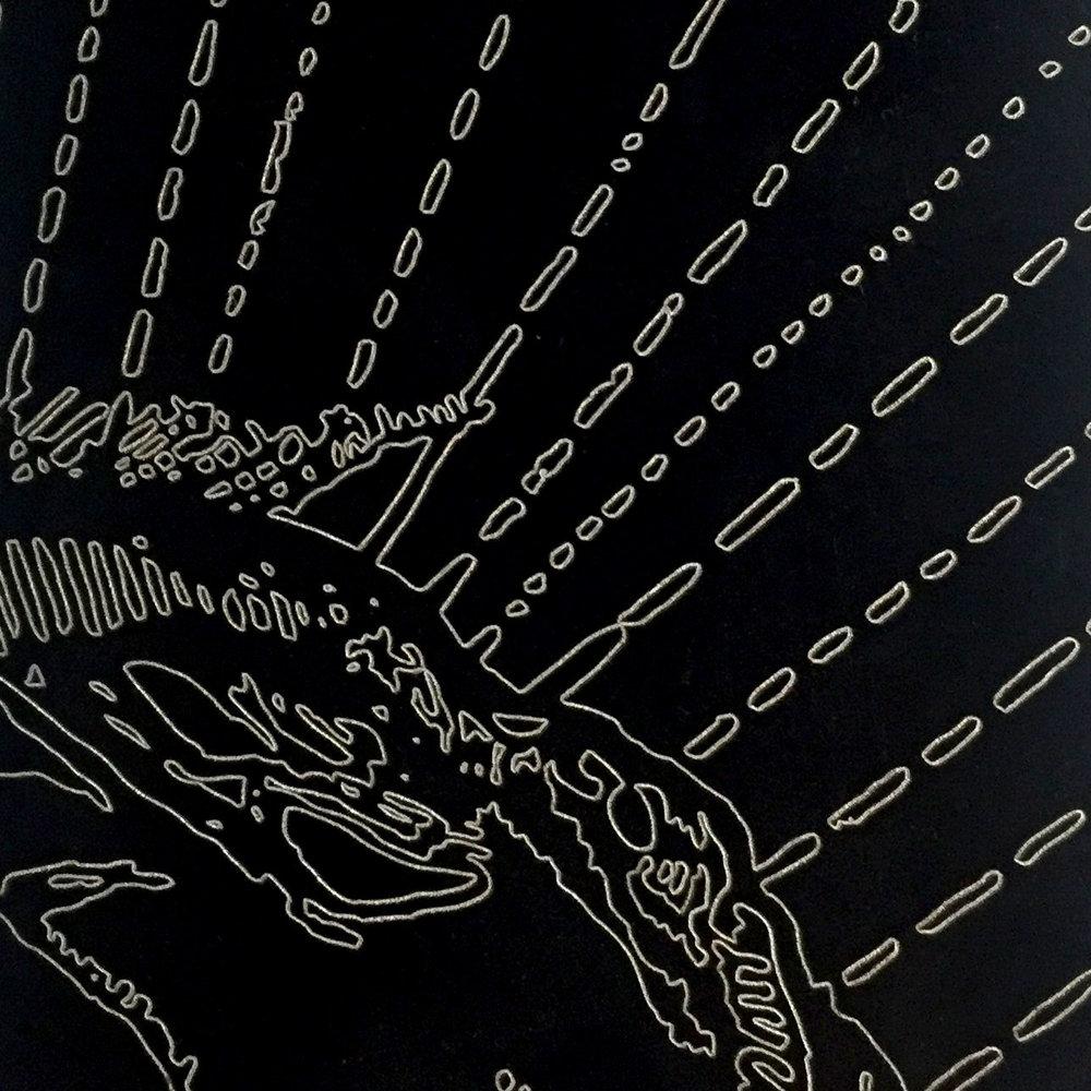 Laser etched black anodized aluminum