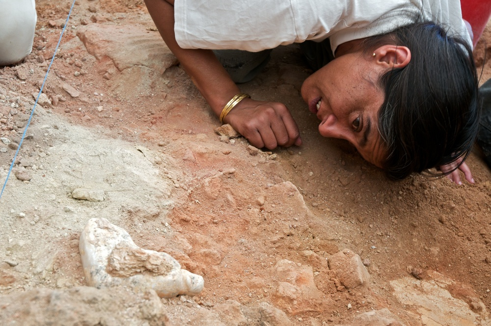 Sahina Farid examining an in situ figuring prior to removal, Çatalhöyük, Turkey.