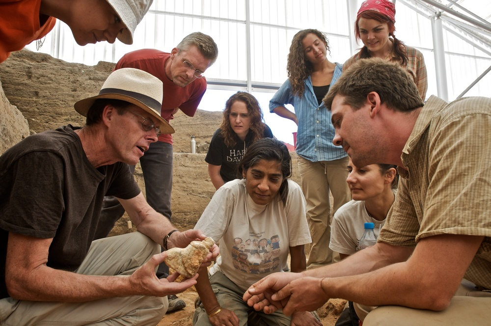 Excitement as the excavation team discovers a new figurine in the South Area, Çatalhöyük, Turkey.