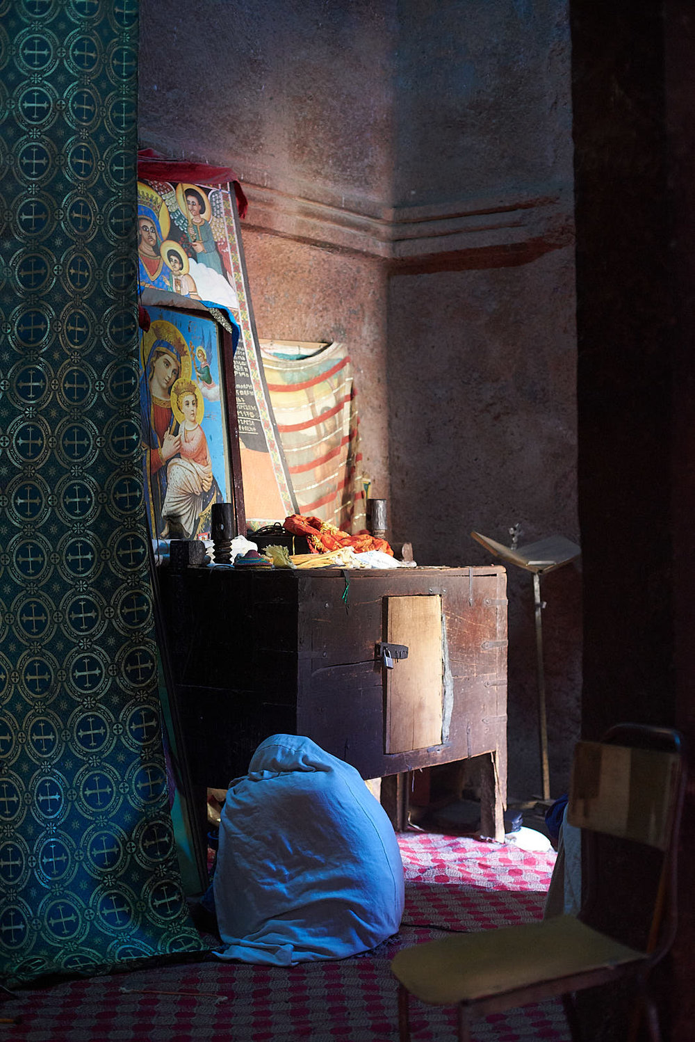 Ethiopian Orthodox pilgrim worshiping inside the Church of Saint George, Lalibela, Ethiopia.