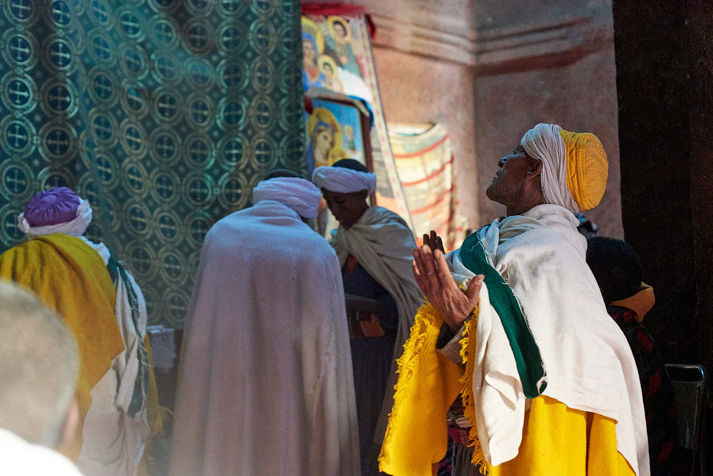 Ethiopian Orthodox pilgrims worshiping inside the Church of Saint George, Lalibela, Ethiopia.