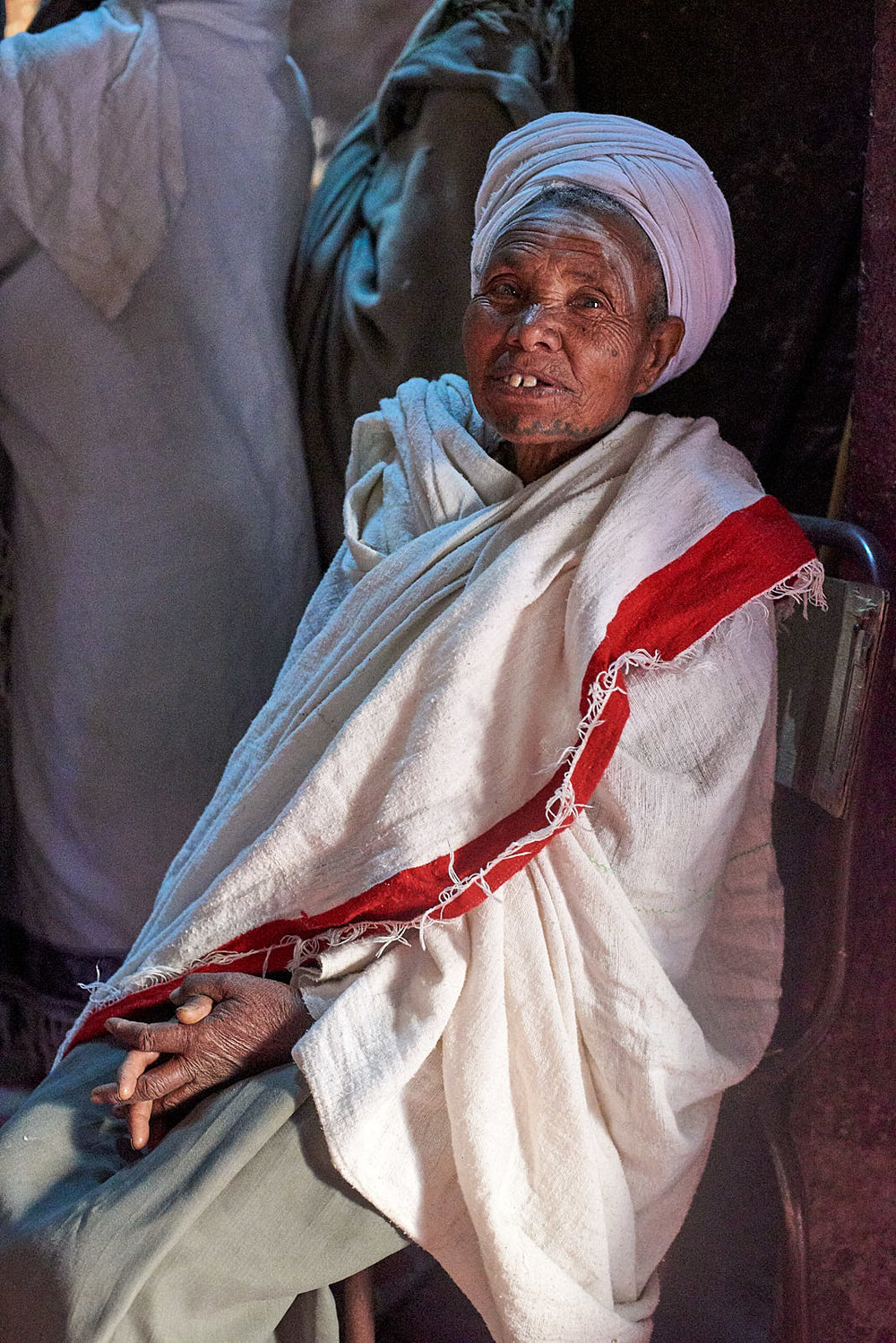 Ethiopian Orthodox pilgrim rests after prayers inside the Church of Saint George, Lalibela, Ethiopia.