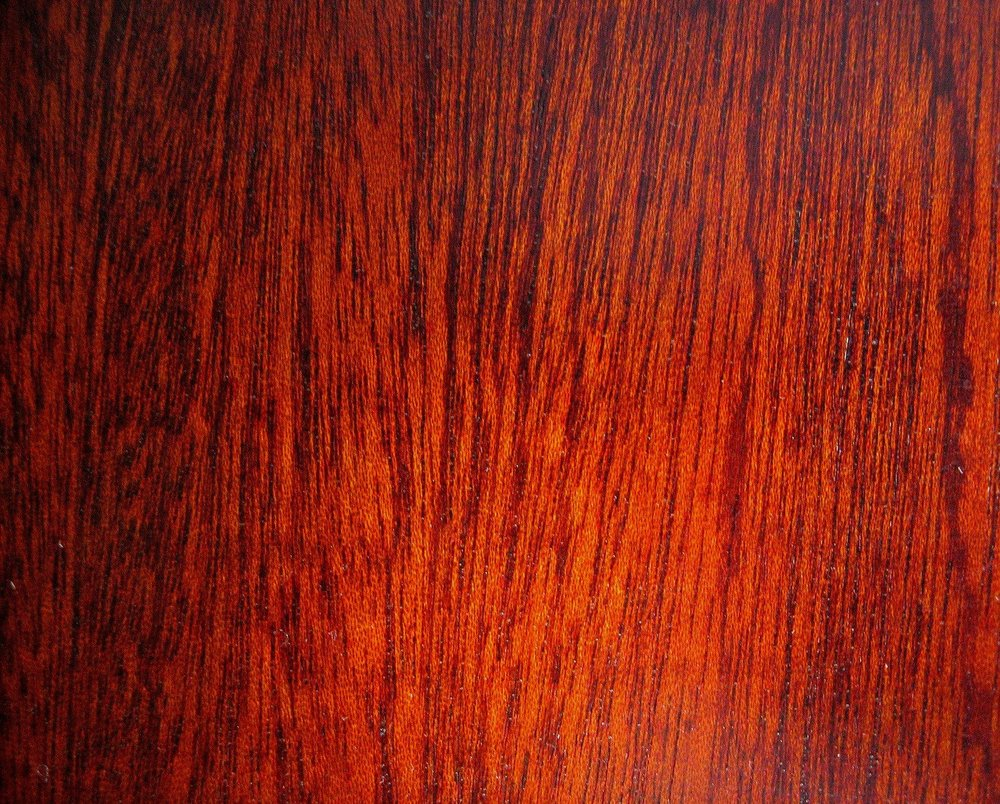 There is a common belief that when it comes to picking a new floor for your home or office, you should stick to the basics – choose something that is not going to offend, or draw undue attention to the floor. As we have mentioned on this blog before, the prevailing opinion when it comes to wood flooring is that you have to choose between light and dark; black or white and sometimes gray. There are other options available, however. For example, one of the colors that tends to be underused and otherwise forgotten about is red. Of course, people are aware that hardwood comes in that color, but you do not usually see it in action, for a variety of reasons. While we here at Ozburn-Hessey are happy to install whatever wood flooring you would like, here are some reasons you might want to consider something beyond the norm. Flaunt it if You've Got it While most people would caution against installing a red wood floor, it is not written anywhere that you need to follow the trends. If you really like something with a little bit more flash, then go for it. For example, a nice cherry flooring, with its rich color and depth, is a great option for someone looking to make a statement. It also makes designing a room a little easier, because you already have the dominant color in play, so you can pick the furniture and the color of the walls and such to match the flooring, not the other way around. And while someone with a dark scheme has to be concerned with the way the color makes the room look smaller and someone with a lighter scheme has to worry about the room appearing too large, a red floor is a nice in-between. Additionally, red tones look nice with a classical design approach, and work with a more modern, stripped down approach as well. Playing With Others All these things also apply to gray. Gray is a more versatile option in a lot of ways, because it is not as powerful a color option. That being said, grey can be used to highlight the modernity of a room, because of the way gray is associated with technology. Both options work well with other shades, so if you are the kind of person who likes every room to have its own feel while maintaining a unified design theme, these are the colors for your home or business. As a bonus, traditionally red and grey wood floors are usually made from oak hardwoods, which is one of the most durable and long-lasting wood flooring options available. So the next time you feel the need to replace your flooring, think Ozburn-Hessey and avoid the impulse to go with the traditional dark or light colors. If you have questions about the sheer number of shades and options outside the big two, or would like to see examples of what this might look like, give us a call and we will help you get started.