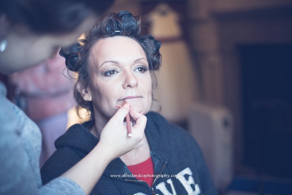 bride having make up done at tissington hall