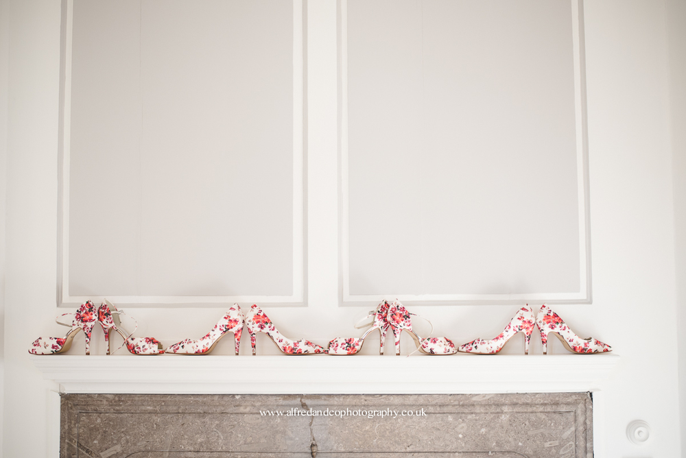 flowery shoes on fire place