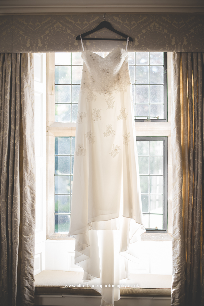 wedding dress hanging in wedding