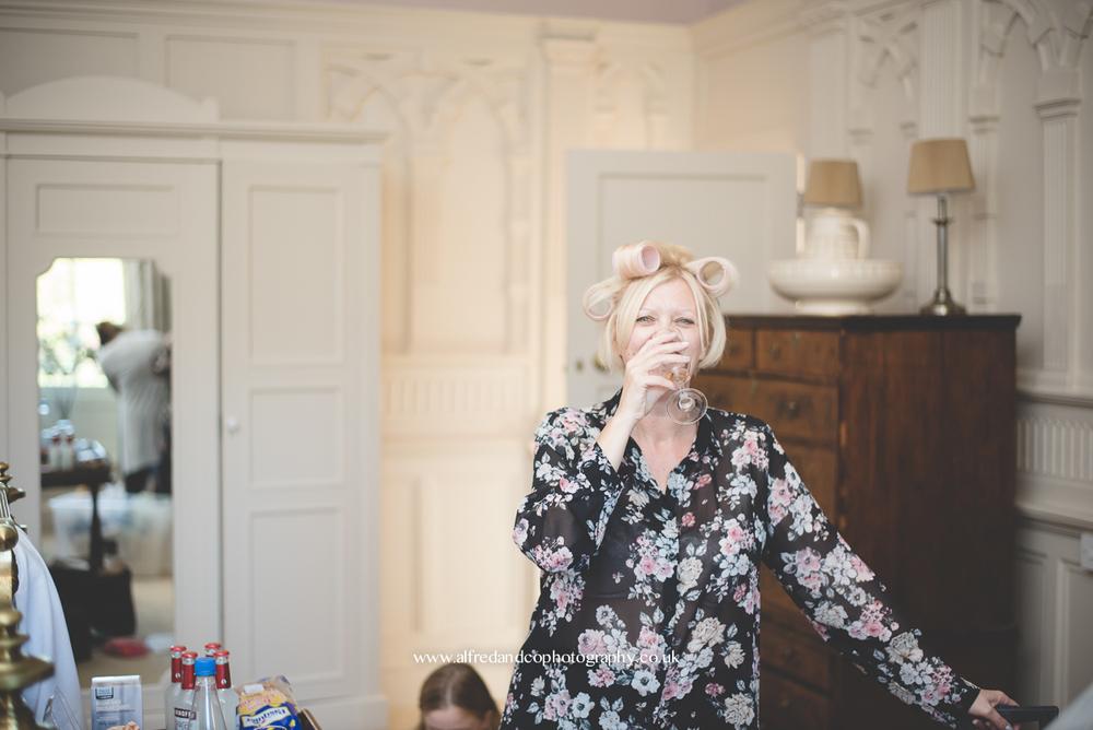 bridesmaid drinking at wedding