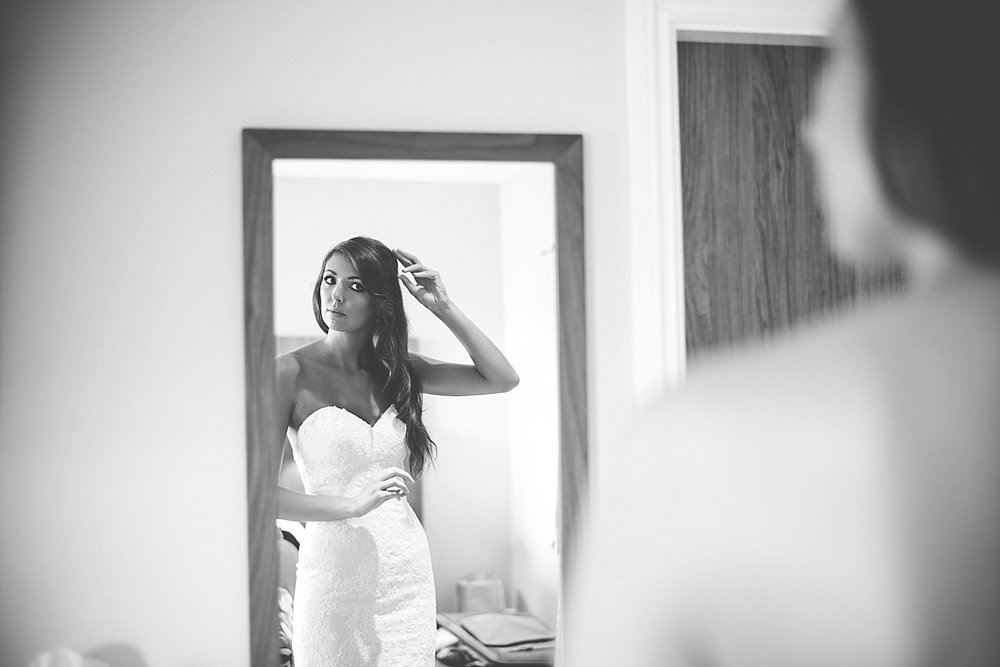 bride looks at self in mirror