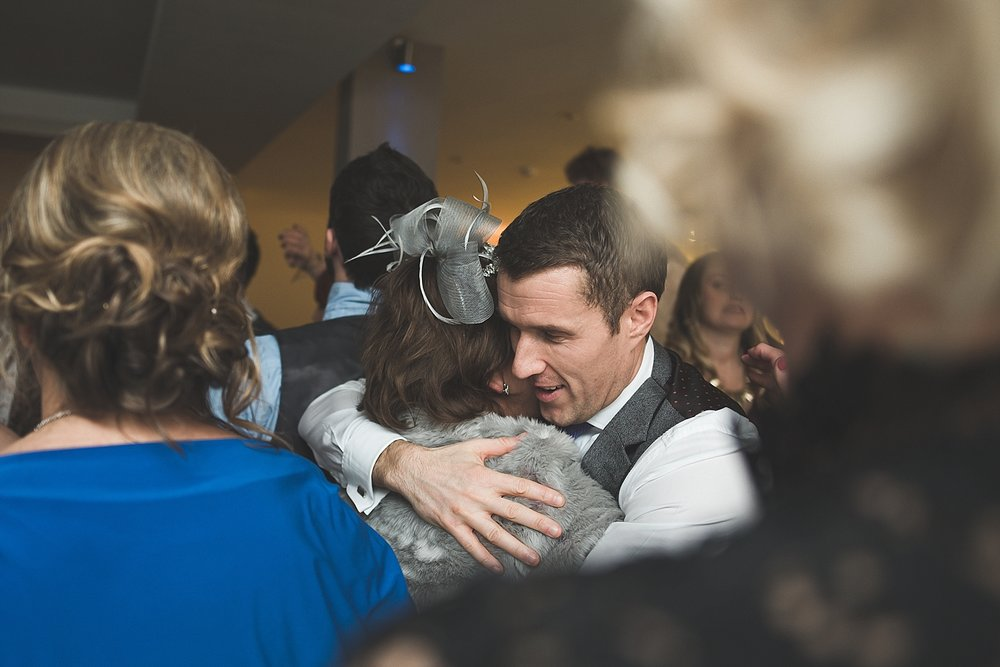 groom hugs mum on dance floor