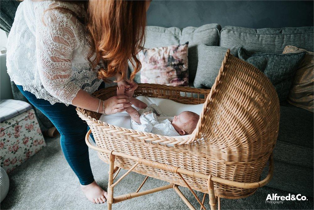 Mum changing baby boy