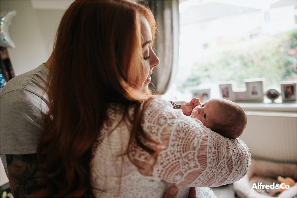 Mummy kissing baby boy