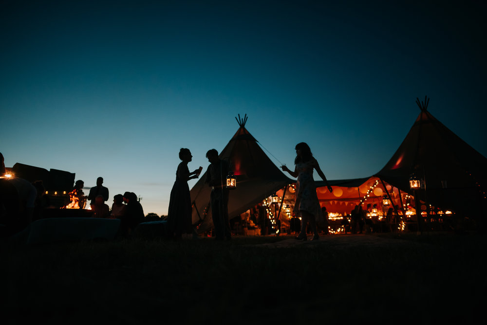 people dancing at a wedding outside