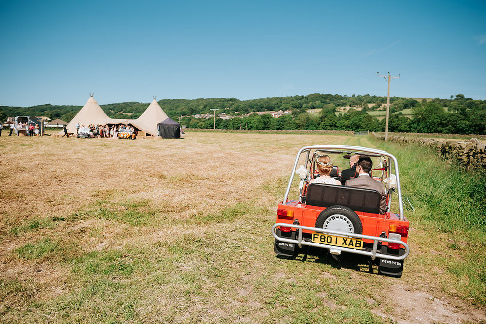 tipi and mini moto at wedding