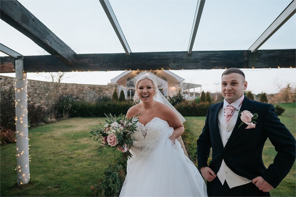 bride and groom outside yorkshire wedding barn