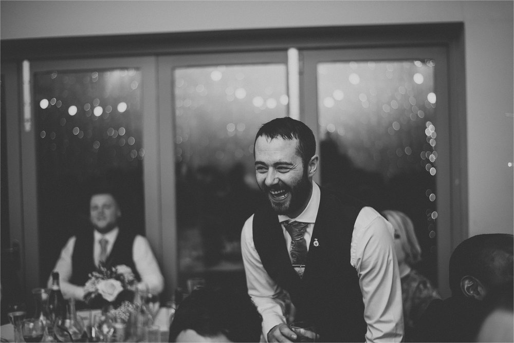 man laughing at wedding party