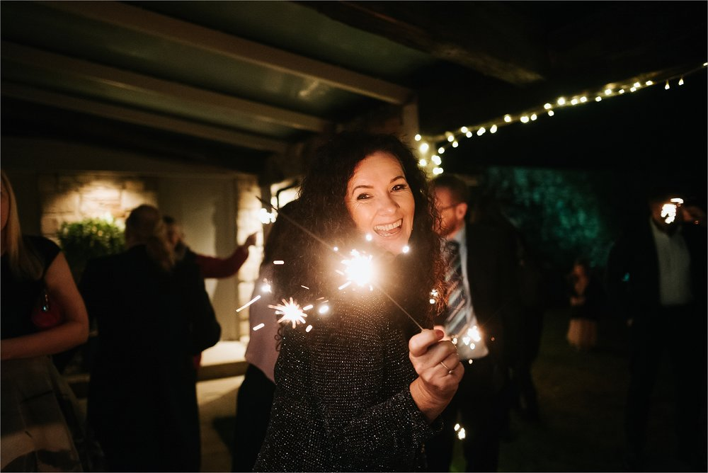 playing with sparklers at wedding