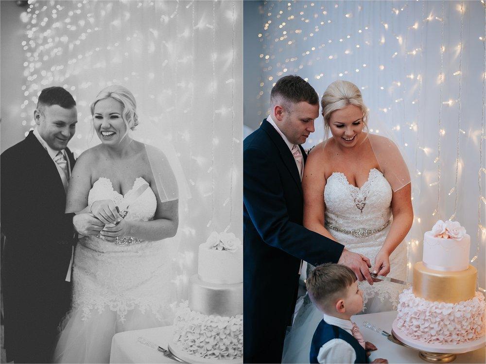 couple cutting cake at wedding