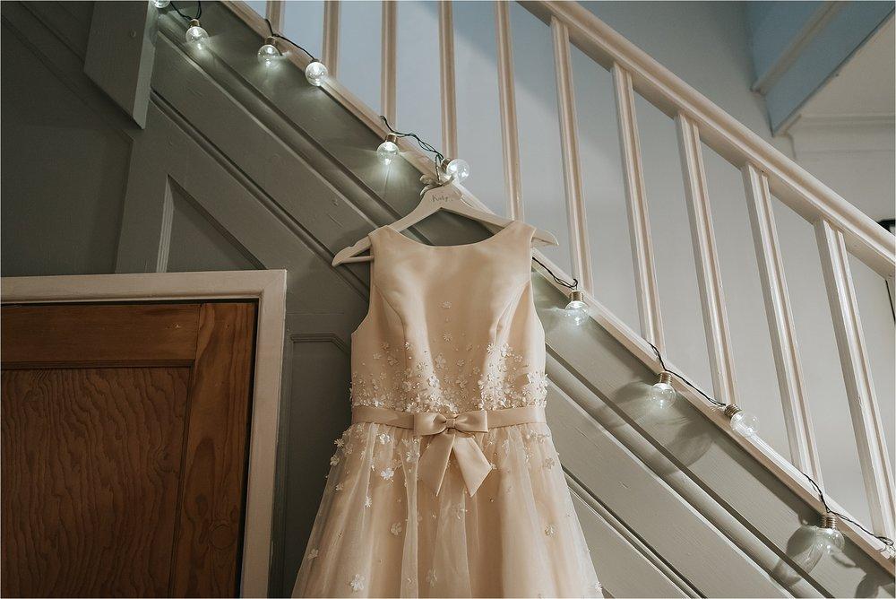 charlotte balbier wedding dress hung up