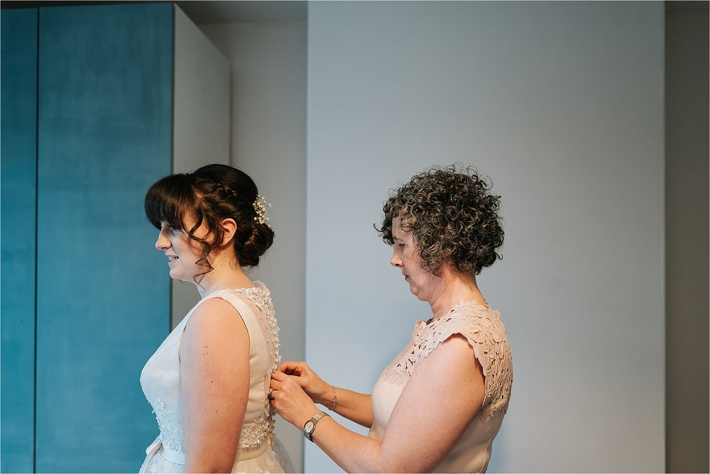 bride getting charlotte balbier gown on