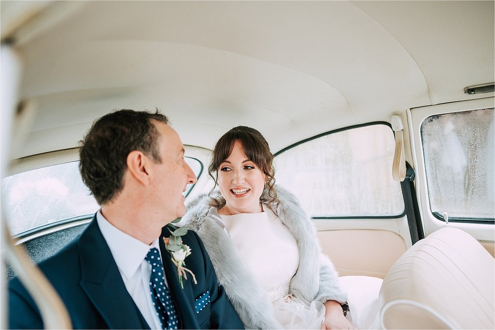 bride in vw beetle with her father
