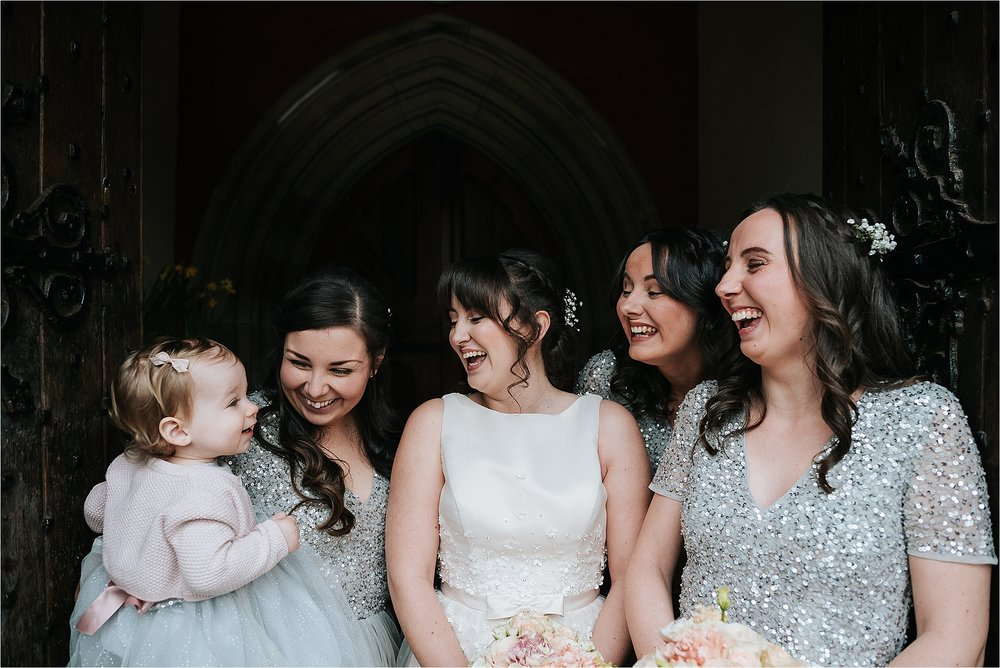 bridesmaids and bride outside church