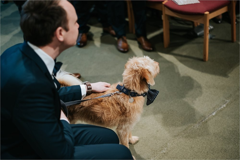 dog waiting at the top of the aisle in the wedding