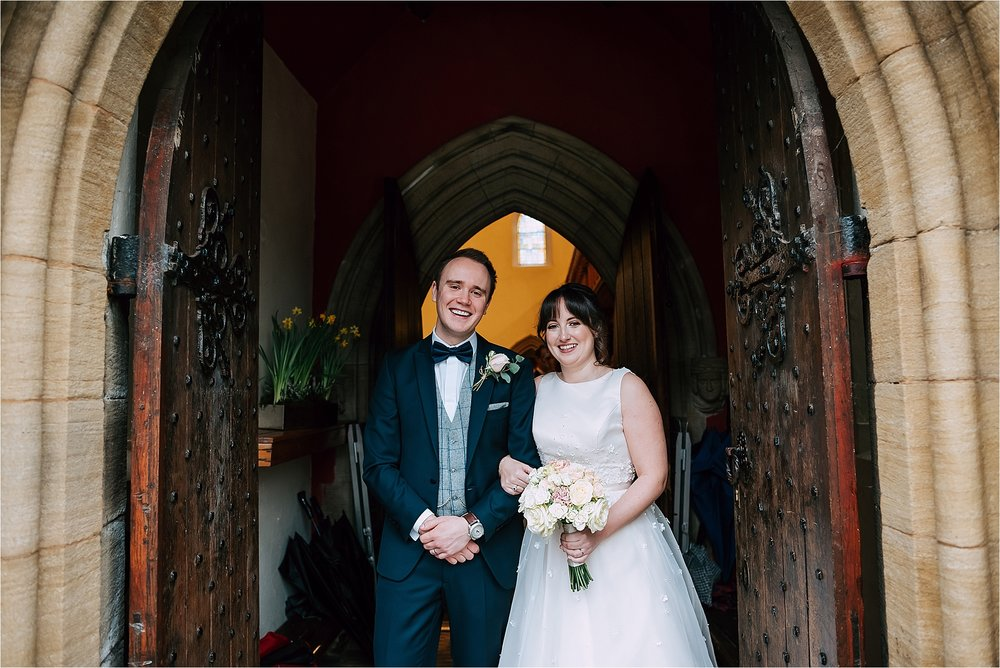 bride and groom outside church in bolton
