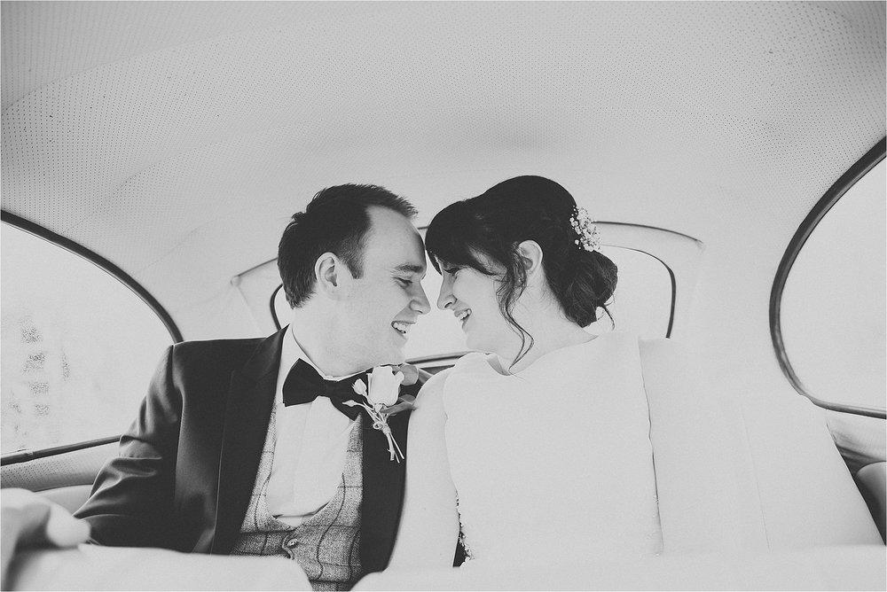bride and groom inside vintage wedding beetle