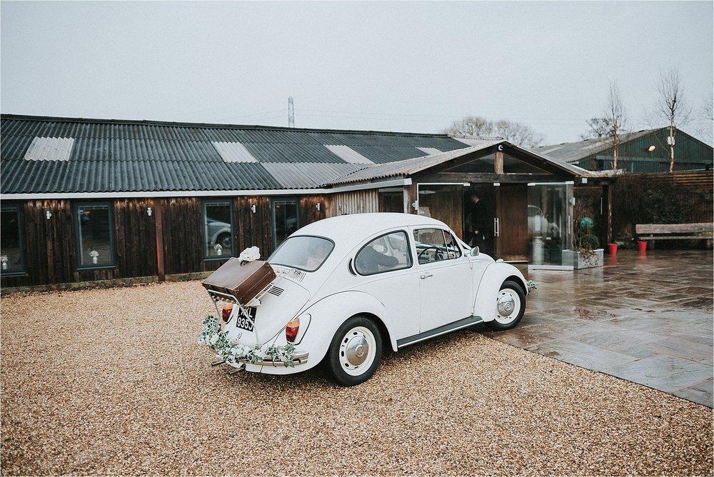 vw beetle outside owen house wedding barn
