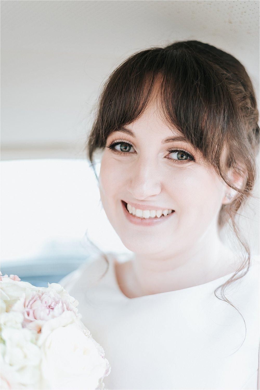 beautiful bride inside vintage vw beetle