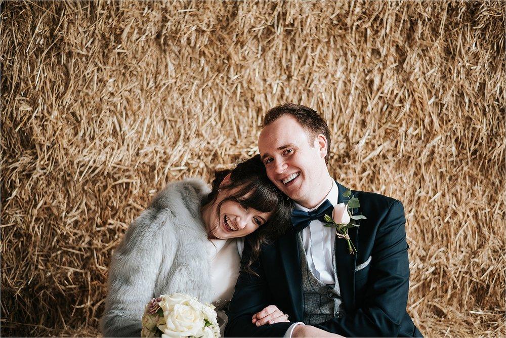 happy couple at owen house wedding barn