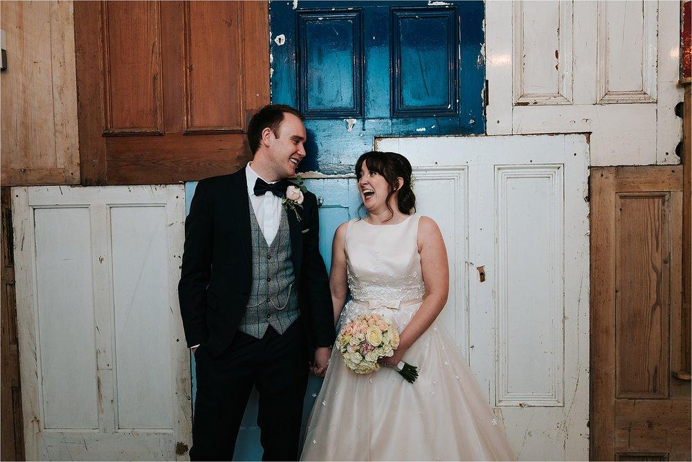 bride and groom at owen house wedding barn