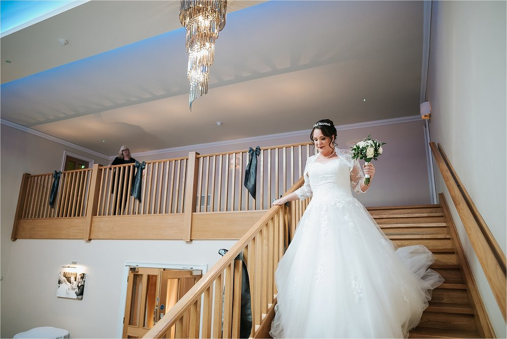 bride walks down steps at the villa