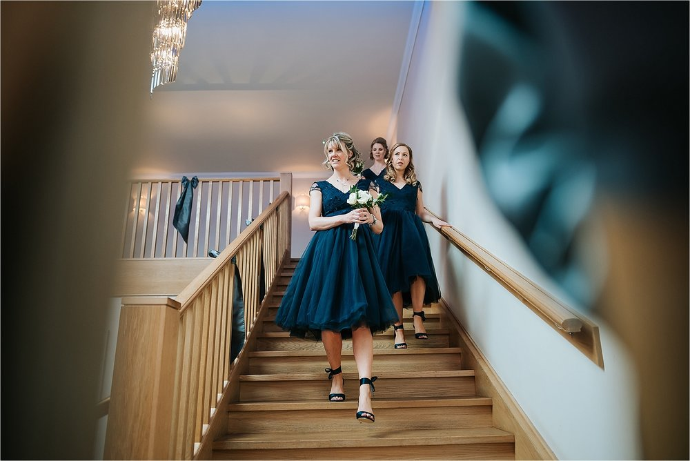 bridesmaids walk down steps