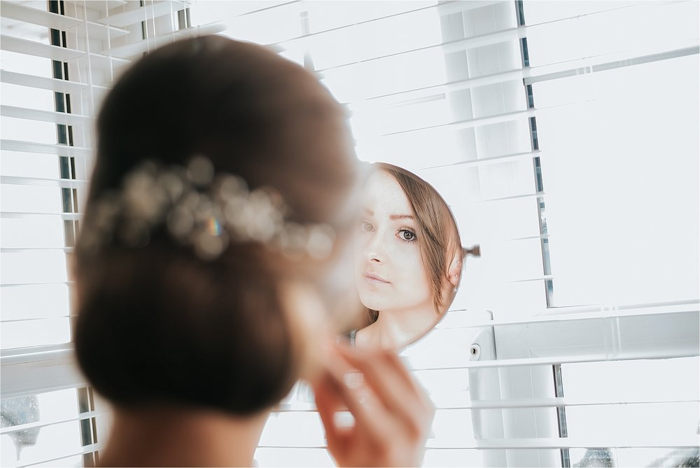 bridesmaid looking in mirror