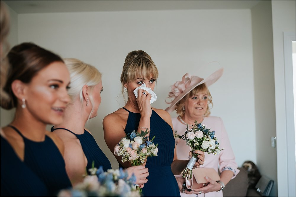 emotional bridesmaid when she sees bride