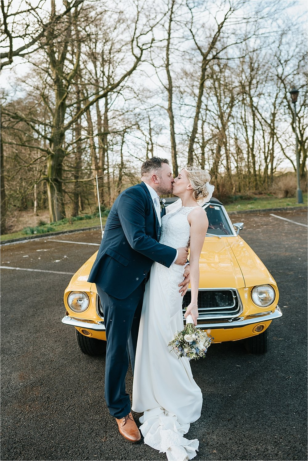 bride and groom with yellow ford mustang